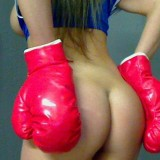 Kate pulls down her boxing shorts and shows off her tight round perfect ass